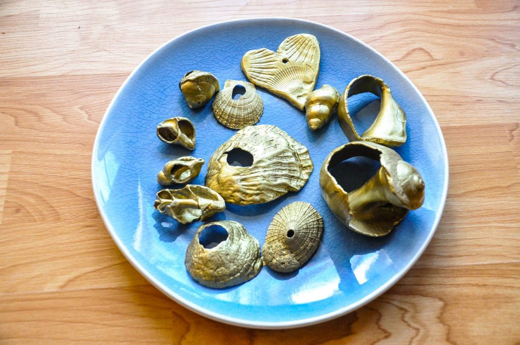 homemade Christmas tree ornaments using shells and gold spray paint