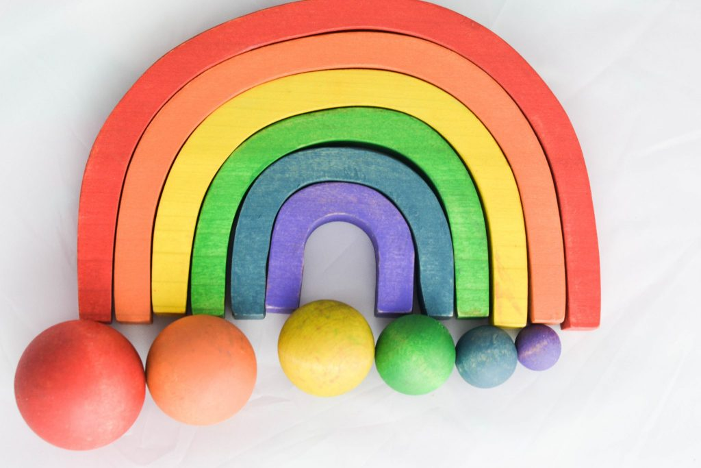 Montessori at Home with a beautiful wooden rainbow game/activity